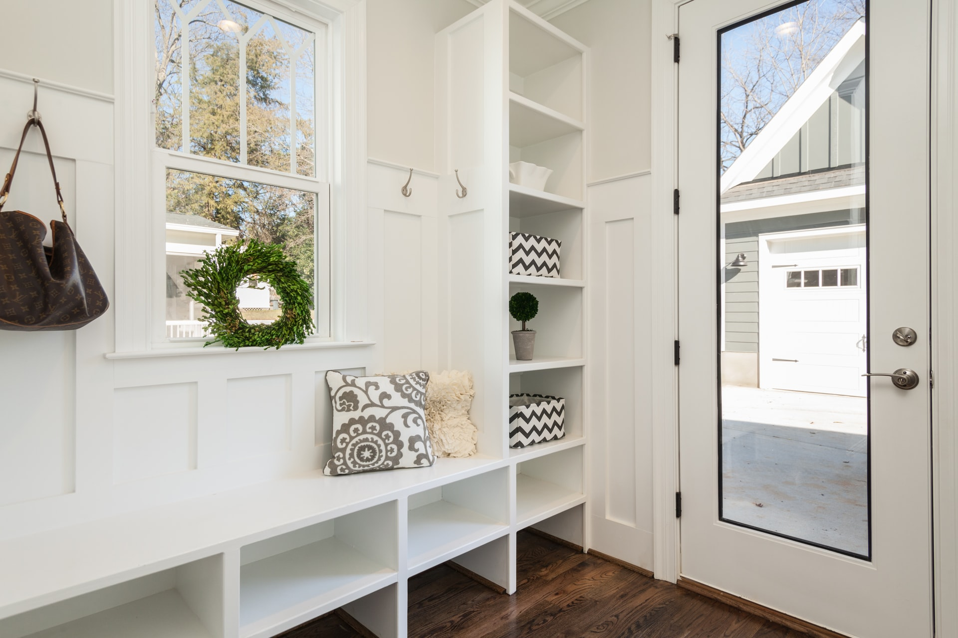 built in shelving and bench to organize and hallway entry