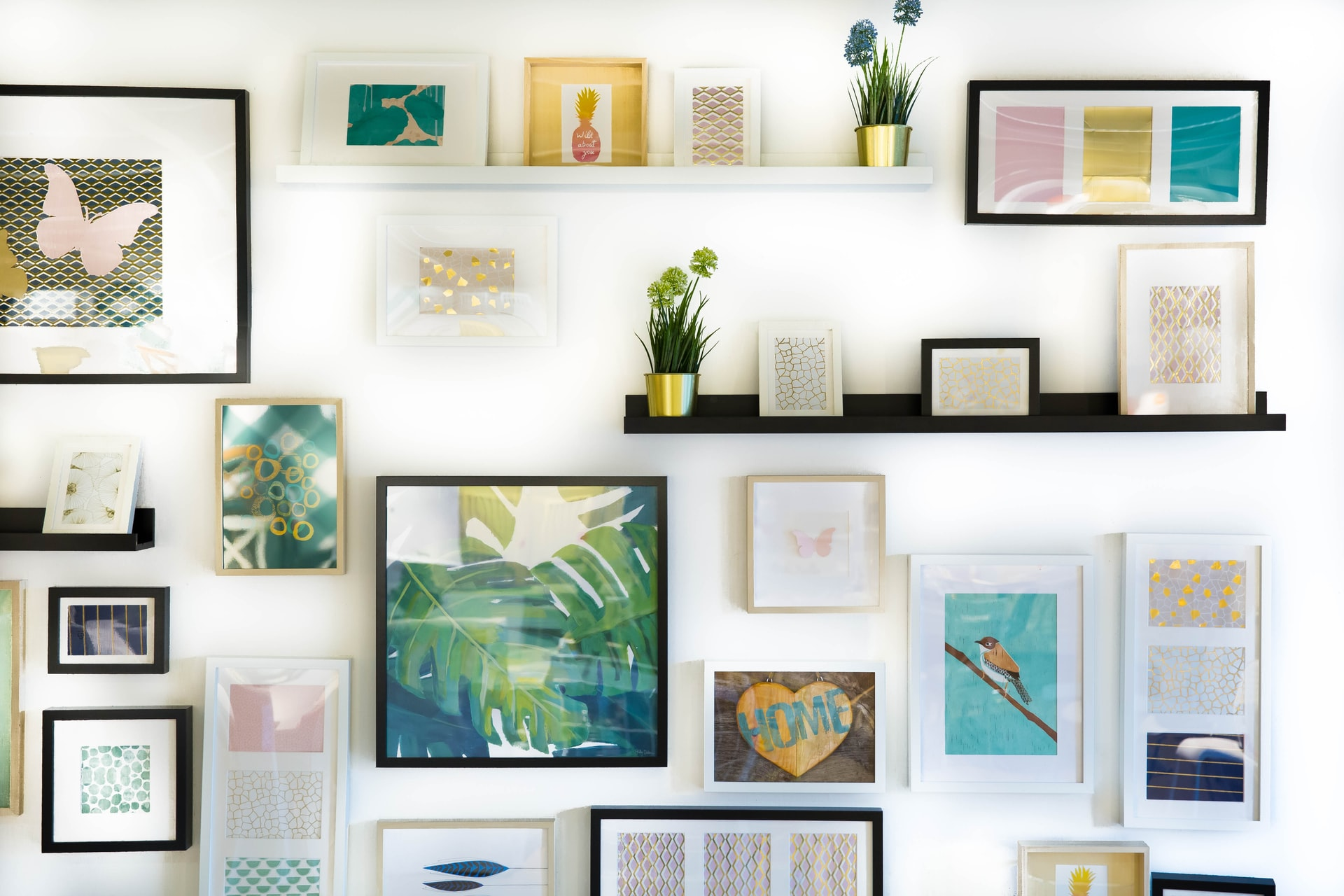 Picture art wall gallery with shelving in a home